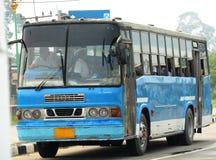 Retro school bus. Driving along street Stock Image