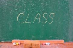 Retro school theme, desk with chalk writing Royalty Free Stock Photography