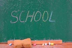 Retro school theme, desk with chalk writing Royalty Free Stock Image