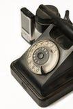 Retro schrijvers uit de klassieke oudheid en moderne telefoons Royalty-vrije Stock Foto's