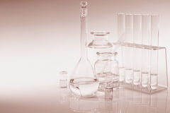 Retro scientific background with chemical glass, flask and tubes Stock Photos
