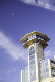 Retro Scifi control tower below small moon. Seafront building actually from Great Yarmouth in the UK. The architecture has a retro feel reminiscent of old scifi Stock Photo
