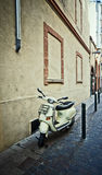 Retro Scooter. Parked retro scooter on a narrow street in Europe Royalty Free Stock Photo