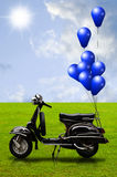 Retro scooter and colorful balloon Stock Photos