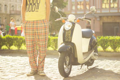 Retro Scooter and driver Stock Photography