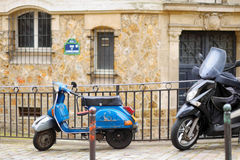 Retro scooter parked on Paris street Royalty Free Stock Photo