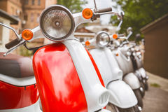 Retro scooter. Standing in a row on the old street Stock Image