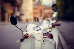Retro scooter. Scooter stands on the old street Royalty Free Stock Images