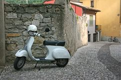 Retro scooter Vespa. On the street in Italy Stock Photos