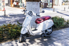 Retro scooter Vespa white color Royalty Free Stock Photos