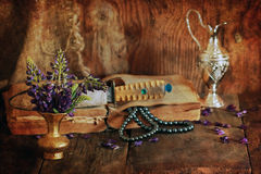 retro scratched effect concept arabian faith with book and flowe royalty free stock photo