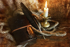 Retro scratched effect on photo book candle feather and rope Royalty Free Stock Photography