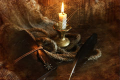 Retro scratched effect on photo book candle feather and rope Stock Image