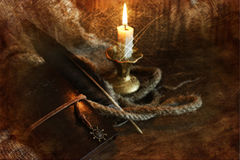 Retro scratched effect on photo book candle feather and rope Royalty Free Stock Photo