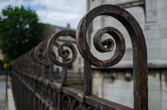 Retro scrolled railings. Retro scrolled metallic railings with a weathered appearance and a shallow depth of field Stock Photography