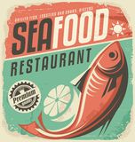 Retro seafood restaurant poster. Vintage fish specialties sign on old paper texture. Promotional ad design template. Food and drink background theme with fish Royalty Free Stock Photography