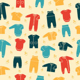 Retro seamless pattern with baby clothes. Vector. Stock Photo