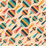 Retro seamless pattern with colorful baby rattles. Stock Photos