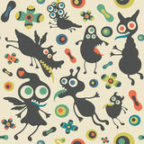 Retro seamless pattern with happy monsters. Stock Image
