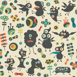 Retro seamless pattern with happy monsters and colorful flowers. Royalty Free Stock Image