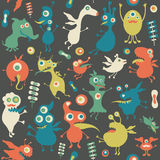 Retro seamless pattern with monsters and flowers. Royalty Free Stock Image