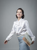 Retro secretary holding documents in a folder Stock Photography
