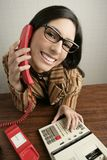 Retro secretary wide angle humor telephone woman. Retro secretary wide angle humor portrait talking telephone woman Royalty Free Stock Images