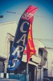 Retro segno di vendita del commerciante di auto usata Fotografia Stock