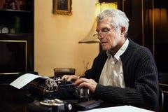 Retro Senior Man writer Royalty Free Stock Photography