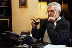 Retro Senior Man writer with a glass of whiskey Stock Photos