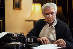 Retro Senior Man writer Stock Image