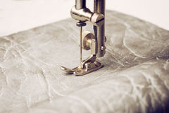 Retro sewing machine needle. Part of work process. Sewing machine leather Royalty Free Stock Image
