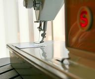 Sewing Machine Needle and White Thread in Sunlight. Retro Sewing Machine Needle and White Thread in Sunlight Stock Images