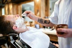 Retro shaving with foam stock photography