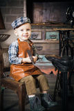 Retro shot of a boy with hammer Royalty Free Stock Image