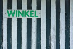 Retro-sign on an old wooden fence. Winkel , Dutch word saying: store Royalty Free Stock Photography