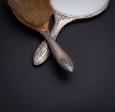 Retro silver mirror and comb royalty free stock image