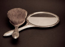 Retro silver mirror and comb Stock Photo