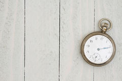 Retro silver pocket watch on weathered wood. With copy space for your message Royalty Free Stock Image