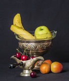 Retro silver ware filled with fresh fruit Stock Photo