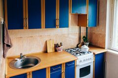 Retro simple kitchen interior design with ugly messy cabinets in need of remodel