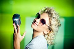 Retro singer. Beautiful young singer with retro microphone Stock Photography