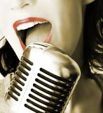 Retro Singer. Girl Singing In The Retro Microphone Royalty Free Stock Photos