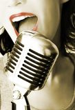 Retro Singer. Girl Singing In The Retro Microphone stock images