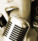 Retro Singer. Girl Singing In The Retro Microphone Royalty Free Stock Photography
