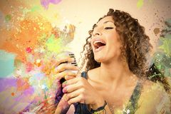 Retro singer. Singer with microphone with color explosion Stock Photography