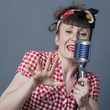 Retro singer in studio with 30s female performing artist Stock Images