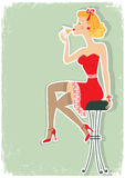 Retro is sitting and drinking martini in red dress Royalty Free Stock Image