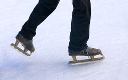 Retro skate on the ice. Blue retro skate on the ice Stock Image