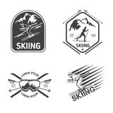 Retro skiing labels, emblems, and logos vector set royalty free illustration